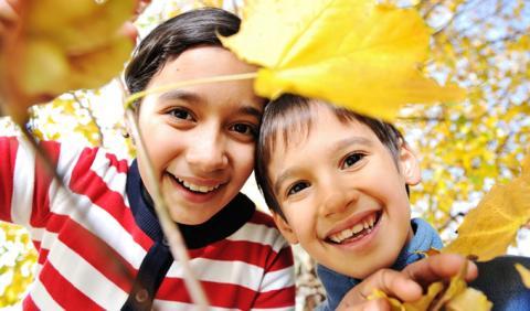 Michigan Kids showing Fall Leaves