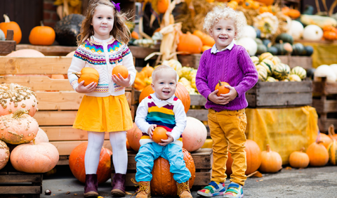Kids with Pumpkins at a Michigan Fall Festival