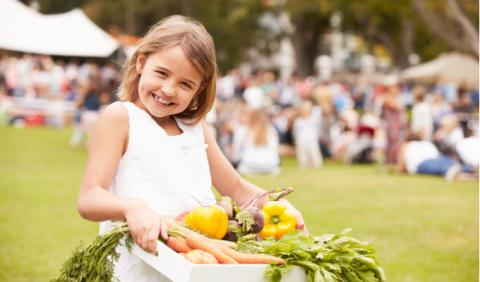 little girl at local Michigan farmers market