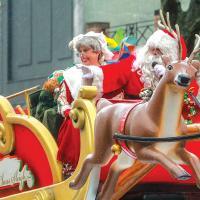 Michigan Families watching Santa and Mrs Claus at a Holiday Parade